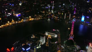 Night View Of TheUrban view of The Bund in Shanghai, China, Asia seen from Shanghai Tower with Huangpu River at night. Landscape in Chinese city with skyline, modern buildings, skyscrapers, Asian architecture Bund From Shanghai Tower China Asia