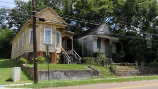 Old abandoned buildings in downtown Natchez, Mississippi, United States of America. Economic crisis and depression with empty wooden houses and homes