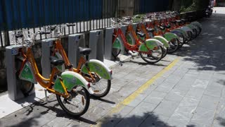 Parking for rental bicycles and bike sharing in Guilin, China, Asia. Bikes for hire in Chinese city, clean transportation