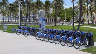 Parking for rental bicycles and bike sharing in South Beach, Miami Beach, Florida, USA. Bikes for hire in American city and clean transportation