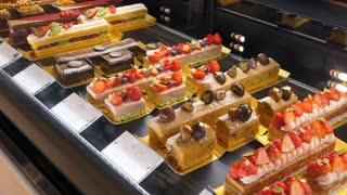 Pastry shop in luxury Tokyo mall, Japan, Asia selling cakes with fruit and berries, sweets and food