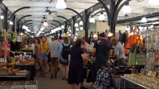 People and tourists shopping for souvenirs at the flea market inside the French Market in the French Quarter of New Orleans, Louisiana, United States of America