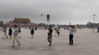 People and tourists walking in Tiananmen Square in Beijing, China, Asia