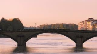 People Canoeing On Arno River Under Santa Trinita Bridge Florence