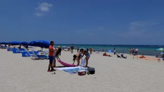 People relax on holiday in South Beach, Miami Beach, Florida, USA. Tourists on summer vacations near the sea. American landscape and recreation in the United States