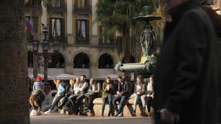 People Tourists Sitting In Placa Reial Royal Square Barcelona