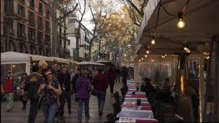 People Tourists Walking On The Rambla In Barcelona Spain