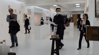 People visit an exhibition in an art gallery in Tokyo, Japan, Asia. Japanese visitors during the opening of an art show and fair