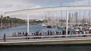 People Walking On The Rambla De Mar In Barcelona Spain