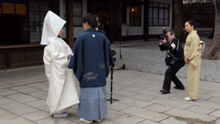 Photo shoot of a traditional Japanese wedding ceremony with bride and groom at Meiji Jingu Shrine in Tokyo, Japan, Asia