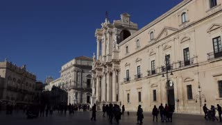 Piazza Duomo in Syracuse, Siracusa, Sicily, Italy. International travel, tourists, people and city view with baroque cathedral in old square