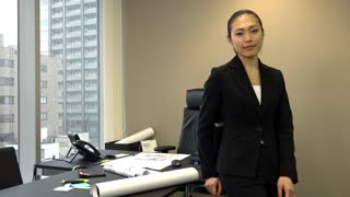 Portrait of Asian people at work in company office. Beautiful Japanese business woman smiling in corporate studio. Confident businesswoman and happy female manager. Slow motion