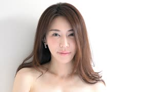 Real Asian people portrait with emotions and feelings. Close-up of pretty face on white background. Beautiful young Japanese woman smiling, sensual girl looking at camera and showing female beauty