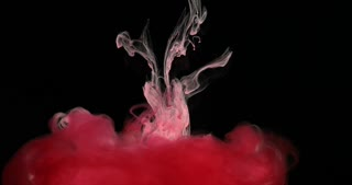 Red Ink Paint in Water Creating Liquid Artistic Shapes