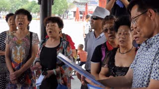 Senior Chinese people singing song in choir in Tianshui, Gansu province, China, Asia