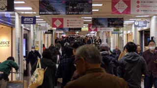 Shinjuku JR railway train station in Tokyo, Japan, Asia with shops and stores. Japanese people, crowd, commuters walking in underground tunnel during morning rush hour