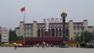 Sichuan Science and Technology Museum in Tianfu square in Chengdu, China, Asia. Landscape in Chinese city with historic building, people, Mao Zedong statue, monument, landmark, red flag