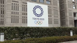 Sign for the Tokyo 2020 Summer Olympics, the Games of the XXXII Olympiad, on a building in Tokyo, Japan, Asia