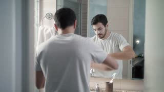 Skin And Body Care For Young Man Applying Anti-aging Cream