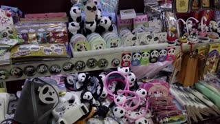 Small shop, Chinese store selling panda toys, souvenirs, gadgets, gifts and presents in Jinli old pedestrian street or Jin Li ancient street in Chengdu, Sichuan, China, Asia