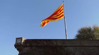Spanish Flag Hanging Out Of Castillo De Montjuic Barcelona