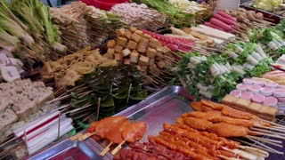 Stall in Zhengning Road, night market, food street in Lanzhou, Gansu province, China, Asia. Small business, family-run shop selling fresh food, vegetables and fruits at local city fair