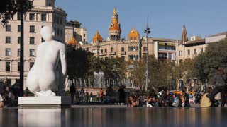 Statue And Tourists In Placa Plaza Catalunya Barcelona Spain