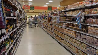 Supermarket in Florida, United States of America. American people shopping for food in store