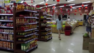 Supermarket in Tianshui, China, Asia. Chinese people, clients, customers shopping for food in shop and store