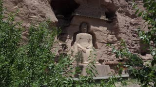 The Bingling Temple, or Bingling Si, in Gansu province, China, Asia. Grottoes, cave and cavern with giant Maitreya Buddha and Buddhist statue. Chinese art, landmark, monument carved in stone
