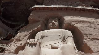 The Bingling Temple, or Bingling Si, in Gansu province, China, Asia. Grottoes, caves and caverns with giant Maitreya Buddha and Buddhist statues. Chinese art, landmark, monument carved in stone