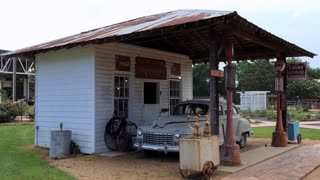 The Mississippi Agriculture & Forestry Museum in Jackson, Mississippi, United States. Old filling station with classic Dodge car