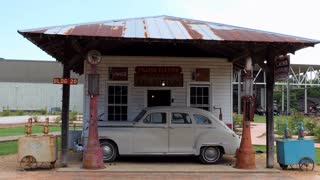 The Mississippi Agriculture & Forestry Museum in Jackson, Mississippi, USA. Old gas station with vintage Dodge car