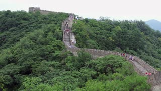 The section of the Great Wall of China in Mutianyu, near Beijing, China, Asia. Crowd, people, tourists visiting the famous Chinese monument. Travel, holidays, tourism, landscape