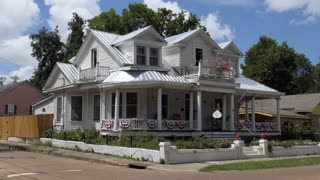 The Watts-Whitmore House in Natchez, Mississippi, United States of America. Old building with American flags and ribbons for the 4th of July (Independence Day) celebrations