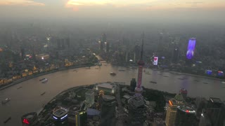 Time-lapse of The Bund of Shanghai, China, Asia seen from Shanghai Tower with Huangpu River at night. Landscape in Chinese city with skyline, modern buildings, skyscrapers, Asian architecture