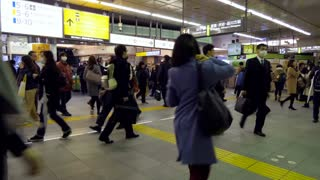 Timelapse of Shinjuku JR station in Tokyo, Japan, Asia with Asian people, tourists and Japanese commuters waiting for a local train arriving at platform. Railway, transport, transportation, travel