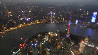 Timelapse of The Bund of Shanghai, China, Asia seen from Shanghai Tower with Huangpu River at night. Landscape in Chinese city with skyline, modern buildings, skyscrapers, Asian architecture