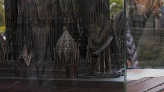 Tourist Looking At Scale Model Of Sagrada Familia Barcelona