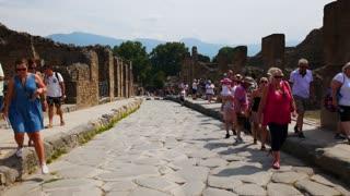 Tourists Walking In Pompeii Site Italy