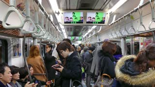 Asian people, tourists and Korean commuters traveling on a subway train in Seoul, South Korea, Asia. Underground railway, transport, transportation, travel