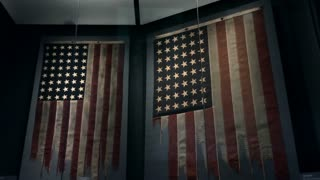 Two American flags torn and ripped during combat in World War II on display at the National WWII Museum in New Orleans, Louisiana, United States of America