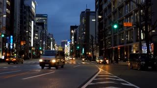 Ueno district in Tokyo, Japan, Asia with cars and street traffic at night. Modern buildings in Asian city and Japanese urban landscape