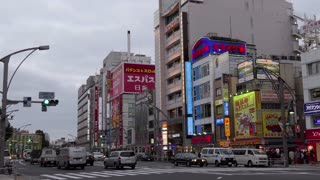 Ueno district in Tokyo, Japan, Asia with cars and street traffic. Modern buildings in Asian city and Japanese urban landscape