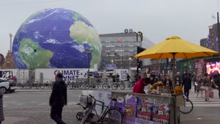 Urban view of Copenhagen, Denmark. Tourist attraction in city center with balloon showing planet Earth and climate change