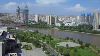 Urban view of Lanzhou, Gansu province, China, Asia with Yellow River. Landscape in Chinese city with skyline, modern buildings, skyscrapers, architecture, construction site