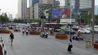Urban view of Renmin South Road in Chengdu, Sichuan, China, Asia. Landscape in Chinese city with modern buildings, downtown road traffic, cars, bikes, pedestrians walking on the street