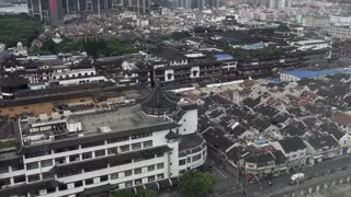 Urban view of Shanghai, China, Asia. Landscape in Chinese city with contrast between modern buildings, skyscrapers and traditional old houses in Asian downtown area