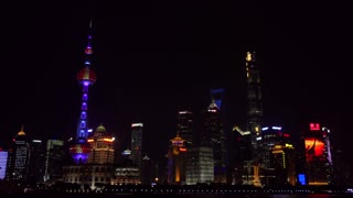 Urban view of The Bund in Shanghai, China, Asia with Huangpu River at night. Landscape in Chinese city with skyline, modern buildings, skyscrapers, Asian architecture in downtown area