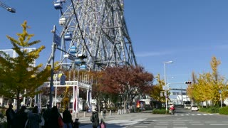 Urban view of the city of Osaka in Japan, Asia with ferris wheel and amusement park, theme park, fair in the ward of Minato, near the Osaka Aquarium